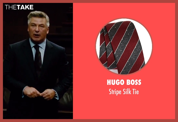 Hugo Boss red tie from Mission: Impossible - Rogue Nation seen with Alec Baldwin (The Head of The CIA)