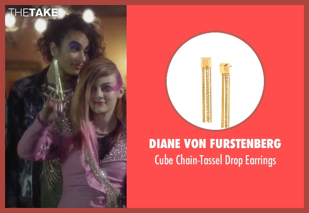 Diane Von Furstenberg	 gold earrings from Jem and the Holograms seen with Aurora Perrineau (Shana Elmsford)