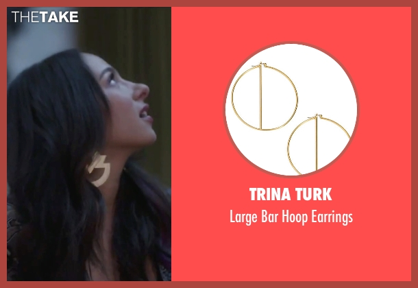 Trina Turk gold earrings from Jem and the Holograms seen with Aurora Perrineau (Shana Elmsford)