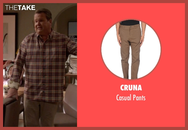 Cruna beige pants from Modern Family seen with Cameron Tucker  (Eric Stonestreet)