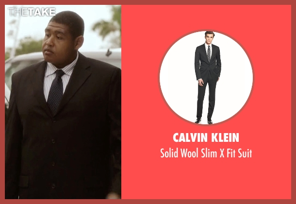 Calvin Klein black suit from Ballers seen with Charles Greane (Omar Benson Miller)