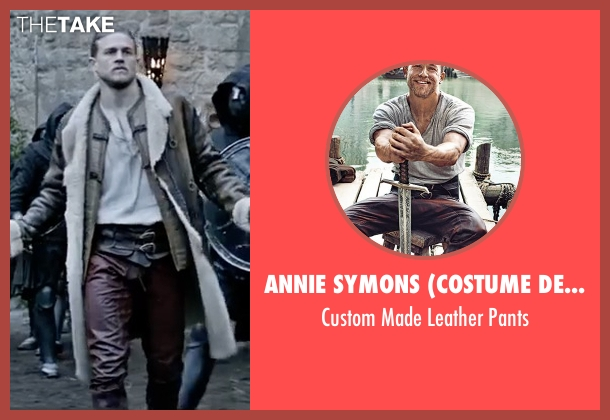 Annie Symons (Costume Designer) purple pants from King Arthur: Legend of the Sword seen with Charlie Hunnam (King Arthur)