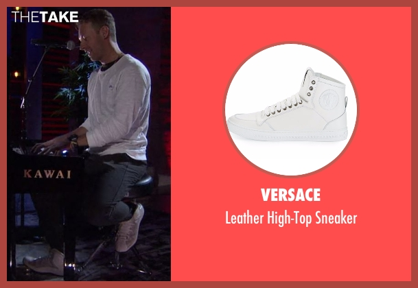 Versace white sneaker from Chelsea seen with Chris Martin