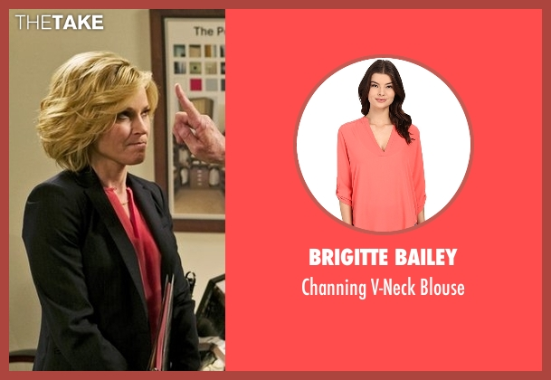 Brigitte Bailey pink blouse from Modern Family seen with Claire Dunphy (Julie Bowen)