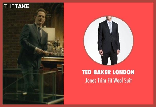 Ted Baker London black suit from John Wick seen with Dean Winters (Avi)