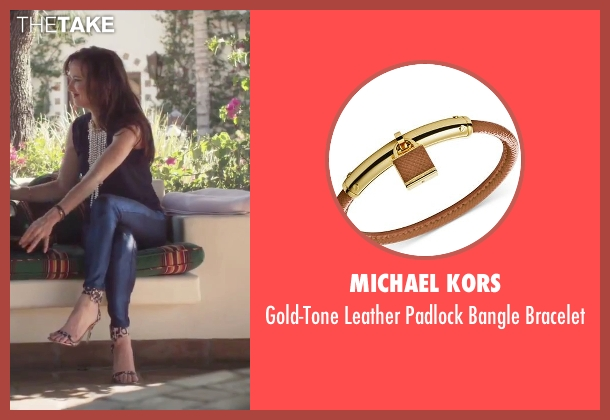 Michael Kors brown bracelet from Jem and the Holograms seen with Juliette Lewis (Erica Raymond)