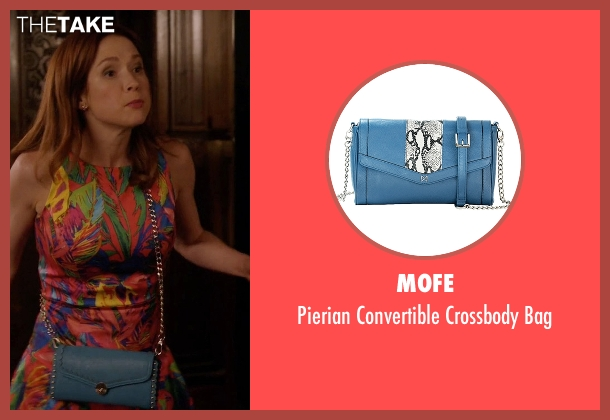 Mofe blue bag from Unbreakable Kimmy Schmidt seen with Kimmy Schmidt (Ellie Kemper)
