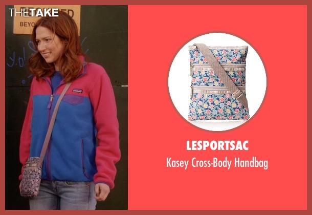 LeSportsac blue handbag from Unbreakable Kimmy Schmidt seen with Kimmy Schmidt (Ellie Kemper)