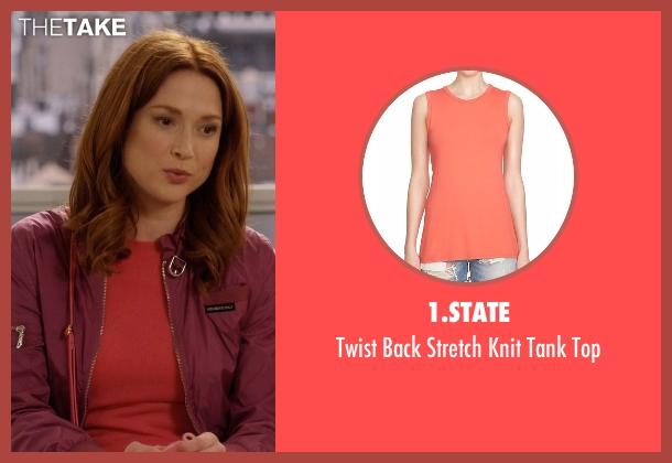 1.State orange top from Unbreakable Kimmy Schmidt seen with Kimmy Schmidt (Ellie Kemper)
