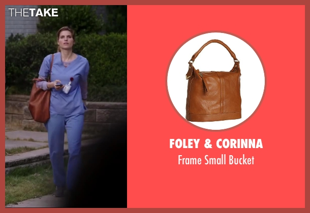 Foley & Corinna brown bucket from Million Dollar Arm seen with Lake Bell (Brenda Paauwe)