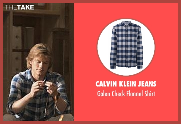 Calvin Klein Jeans blue shirt from MacGyver seen with MacGyver (Lucas Till)