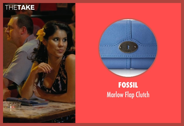 Fossil blue clutch from Hall Pass seen with Maria Duarte (Latino Woman # 2)