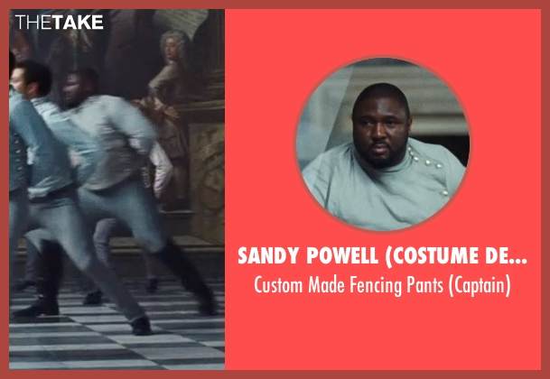 Sandy Powell (Costume Designer) gray pants from Cinderella seen with Nonso Anozie (Captain)