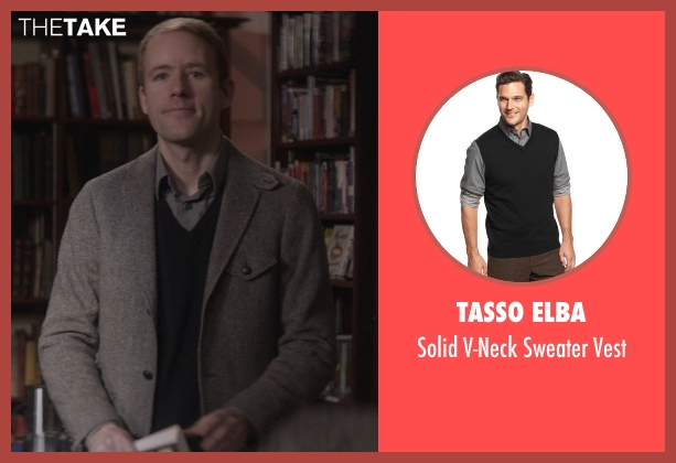 Tasso Elba black vest from That Awkward Moment seen with Reif Larsen (Famous Author)