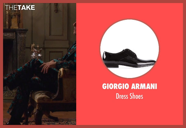 Giorgio Armani black shoes from The Hunger Games: Mockingjay Part 1 seen with Stanley Tucci (Caesar Flickerman)