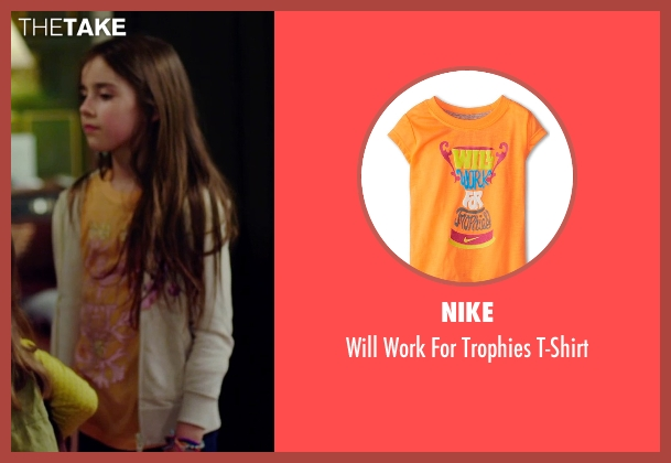 Nike orange t-shirt from No Escape seen with Sterling Jerins (Lucy Dwyer)