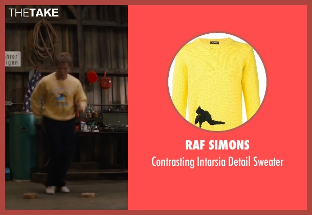 Raf Simons yellow sweater from Eddie The Eagle seen with Taron Egerton (Eddie Edwards)