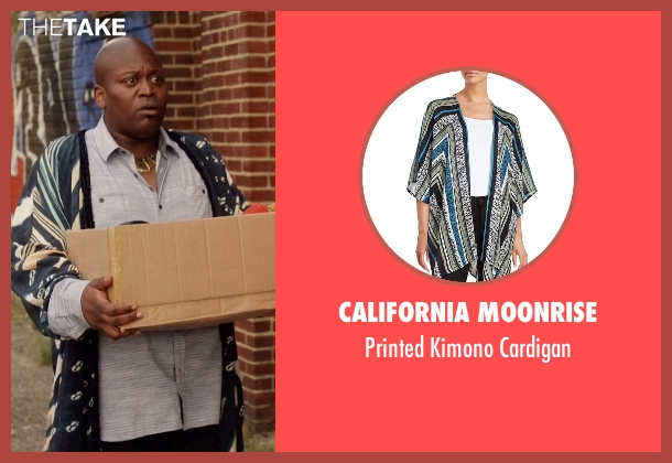 California Moonrise blue cardigan from Unbreakable Kimmy Schmidt seen with Titus (Tituss Burgess)