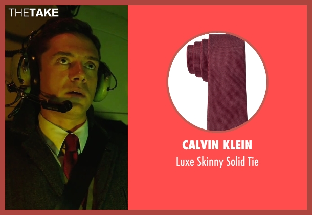 Calvin Klein red tie from American Ultra seen with Topher Grace (Adrian Yates)