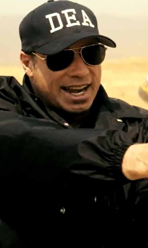 John Travolta with Ultimate Flags DEA Cap in Savages