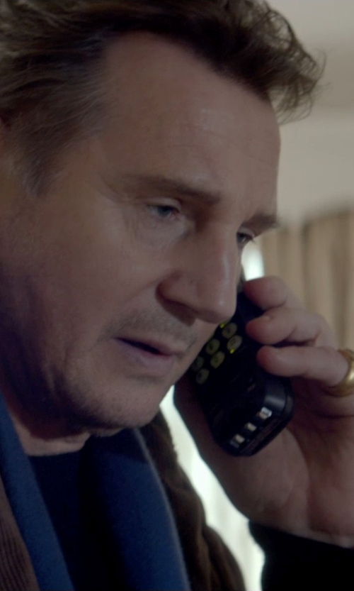 Liam Neeson with Clocks and Colours Bucko Brass Ring in A Walk Among The Tombstones