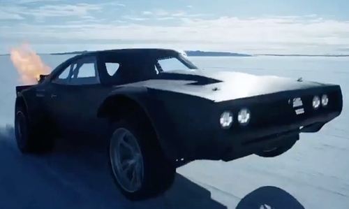 Vin Diesel with Dodge 1970 Charger Coupe in The Fate of the Furious