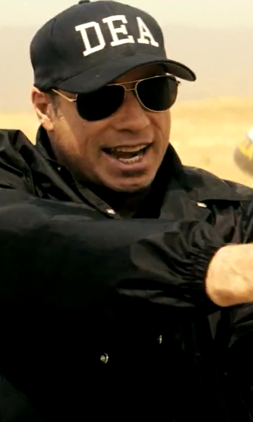 John Travolta with Lacoste Aviator Sunglasses in Savages