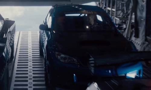 Paul Walker with Subaru Impreza WRX STi Sedan in Furious 7