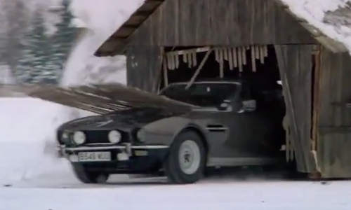 Timothy Dalton with Aston Martin 1985 V8 Vantage Series III Convertible Car in The Living Daylights