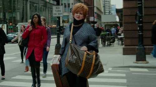Melissa McCarthy with Louis Vuitton Brown Travel Bag in The Boss