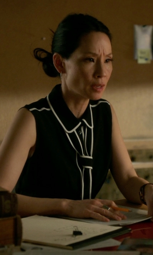 Lucy Liu with Boutique Moschino Tie Neck Dress in Elementary