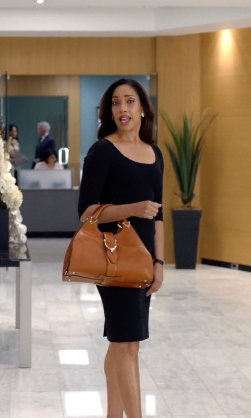 Gina Torres with Gucci Stirrup Leather Top Handle Bag in Suits