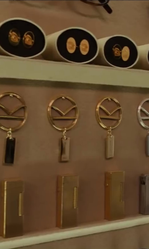 Colin Firth with Kingsman + Deakin & Francis Rose Gold-Plated Crest Cufflinks in Kingsman: The Secret Service