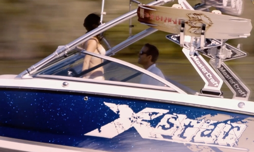 Ryan Reynolds with Mastercraft X-Star Powerboat in Self/Less