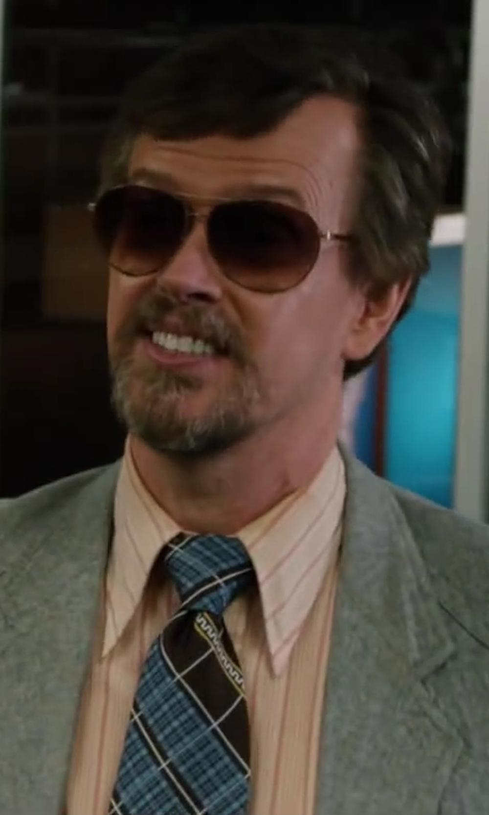 Dylan Baker with Original Penguin Plaid Tie in Anchorman 2: The Legend Continues
