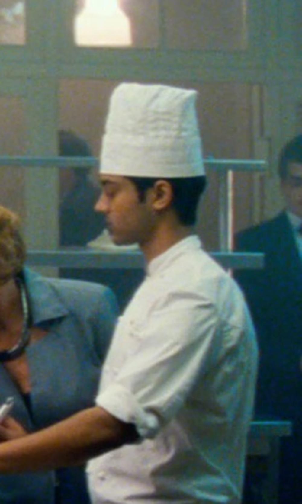 Manish Dayal with WebstaurantStore Fluted Disposable Chef Hat in The Hundred-Foot Journey