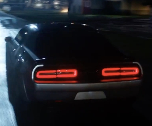 Michelle Rodriguez with Dodge Challenger Muscle Car in The Fate of the Furious