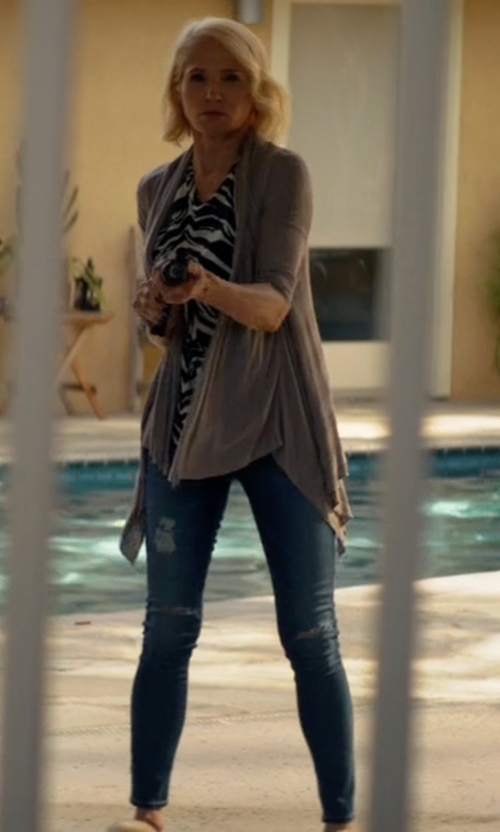 Ellen Barkin with AG The Legging Distressed Ankle Jeans in Animal Kingdom