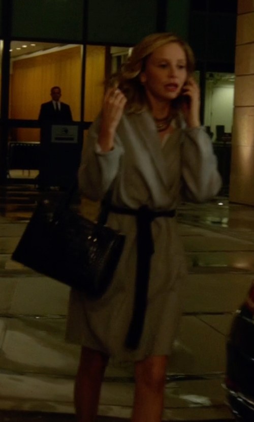 Calista Flockhart with Jessica Simpson Basketweave Wrap Coat in Supergirl