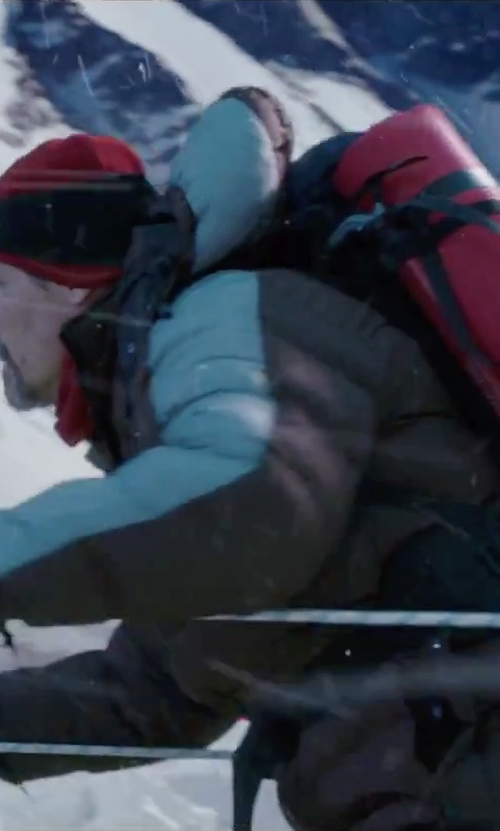 Josh Brolin with Marmot Men's Guides Down Hooded Jacket in Everest