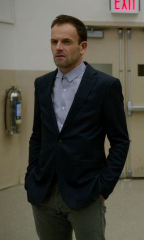 Jonny Lee Miller with Hart Schaffner Marx New York Classic Fit Navy Wool Blend Blazer in Elementary