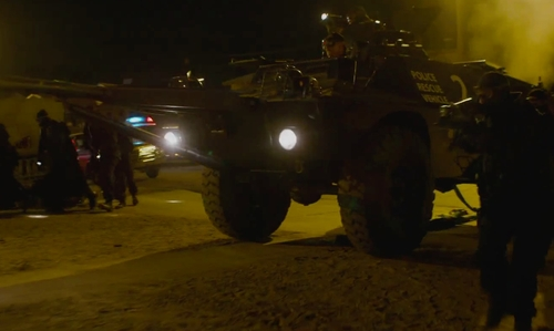 Unknown Actor with Cadillac Gage Commando LAV 100 in Straight Outta Compton
