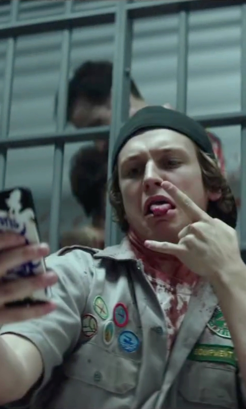 Logan Miller with Apple iPhone 5s in Scout's Guide to the Zombie Apocalypse