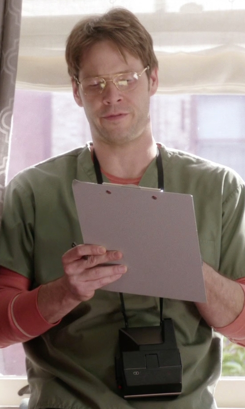 Ike Barinholtz with Polaroid Polaroid One Step Close-Up 600 Instant Camera in The Mindy Project