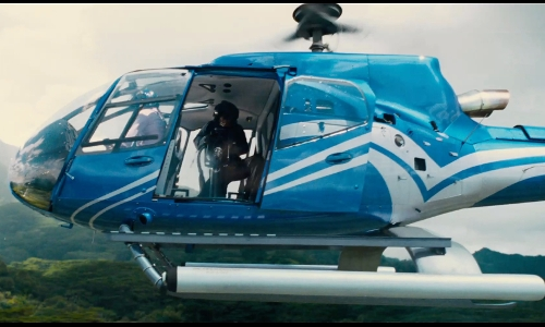 Unknown Actor with Blue Hawaiian Eurocopter EC130 Helicopter in Jurassic World