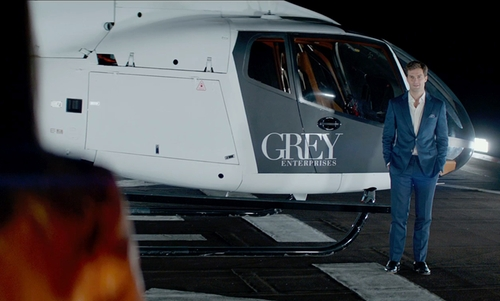 Jamie Dornan with Eurocopter EC130 B4 Helicopter in Fifty Shades of Grey