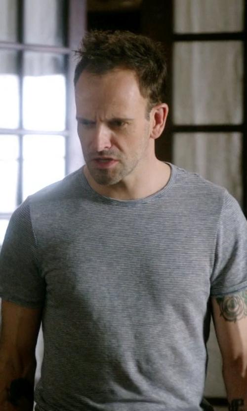 Jonny Lee Miller with A Deep Stripe T-Shirt in Elementary