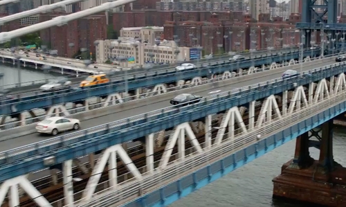 Unknown Actor with Manhattan Bridge New York City, New York in The Fate of the Furious