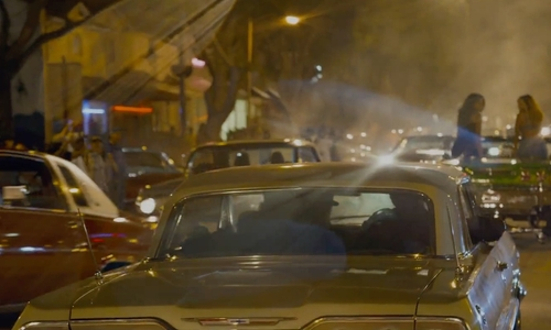 Jason Mitchell with Chevrolet 1964 Impala Coupe in Straight Outta Compton