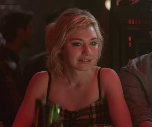 Imogen Poots with BCBGENERATION Floral Faux Leather Bustier Dress in That Awkward Moment